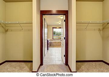 Hallway interior. Opened door to bathroom with tile floor.