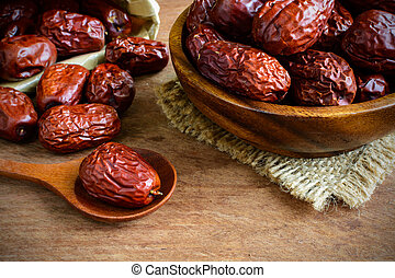 Dried jujube fruits on wooden table - Dried jujube fruit on...