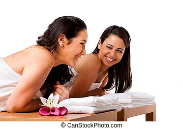 Women having fun at spa - Two beautiful women friends laying...
