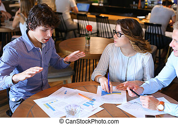 Business team negotiates talk and discuss - Two smart young...