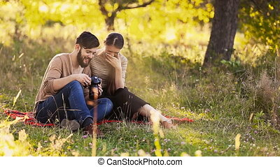 young couple looks into the camera