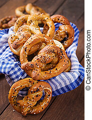 Oktoberfest salted soft pretzels in a bowl from Germany on wooden background
