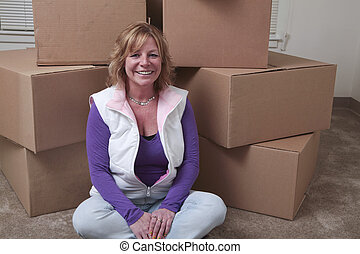 Moving in - Attractive Caucasian woman sits in front of a...