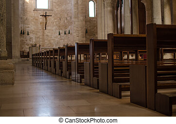 Benches of a catolic italian church