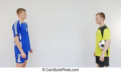Soccer Player and Referee Greeting Each Other on White...