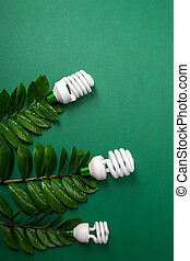 Three LED lamp with green leaf, ECO energy concept, close up. Light bulb on  background. Saving  and Ecological Environment. Copy space.