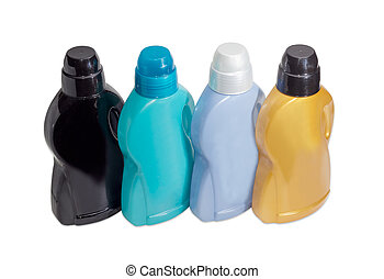 Four plastic bottles with different liquid detergent on light background