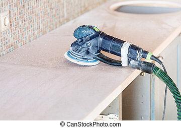 random orbital sander on new countertop - installing new...