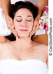 Luxury facial massage - Skincare consultant applying facial...