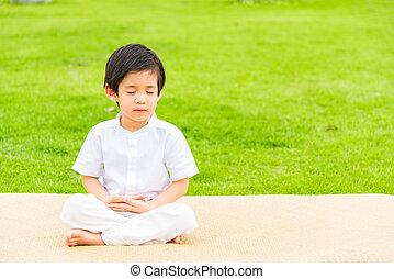Close up of cute buddhist asian boy