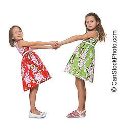 Girls holding hands - Two beautiful little girls in fancy...