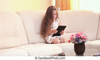little girl with the tablet - Little girl with tablet...