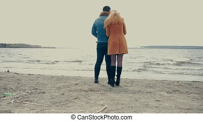 Couple Standing on a Beach and Talking - Boyfriend and...