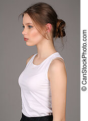 Girl standing profile. Close up. Gray background - Girl...