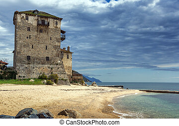 Ouranopoli, Athos, Greece - Seascape with Medieval tower in...