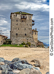 Ouranopoli, Athos, Greece - Beach and Medieval tower in...