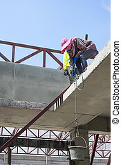 Woman labor worker in construction