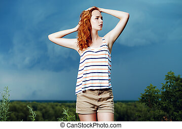 thunderstorm - Portrait of a beautiful young woman on the...