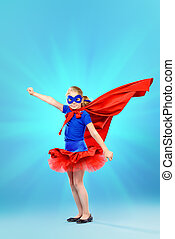 girl superhero - Little girl playing in superhero. Studio...