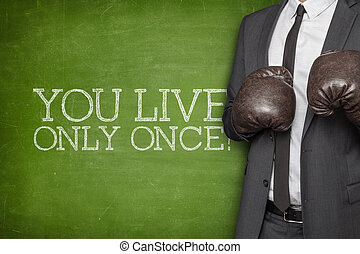 You live only once on blackboard with businessman on side -...