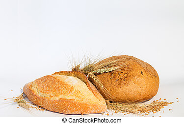 Bread with ears of wheat on a white background