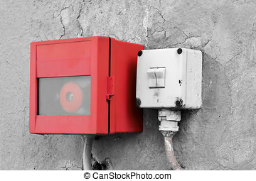 emergency switch and light switch on the wall of a factory...