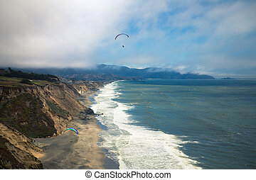 California Paragliding - Ocean Paraglider along the coast of...
