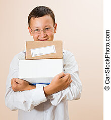 Boy with boxes of parcels in the hands