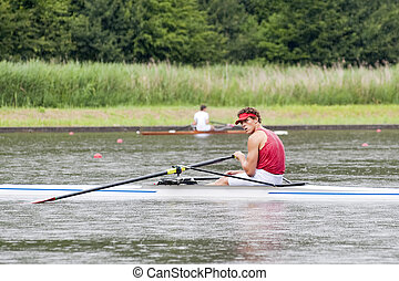 Skiff Rowing - A skiff oresman, waiting for the start in the...