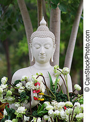 Buddhism worship with offering flowers and garland to buddha...