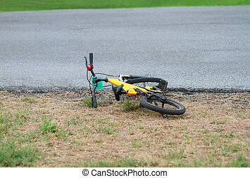 Yellow bike fell off beside the street