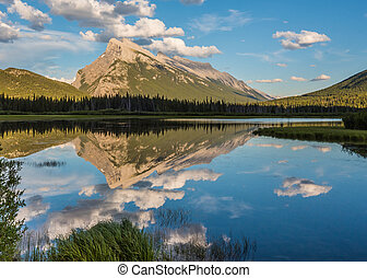 Mt. Rundle reflects in Vermilion Lakes on a calm summer day