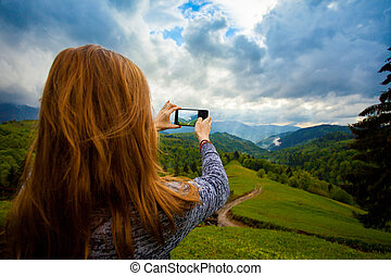 Amazing view of summer landscape - Young woman is standing...