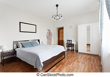 Bright bedroom with double bed