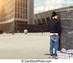 Vagrant peeing - Blushless vagrant peeing on the street in...