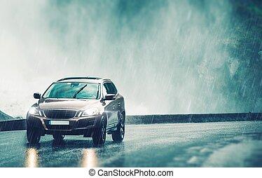 Driving Car in Heavy Rain. Modern Compact SUV Car Speeding...