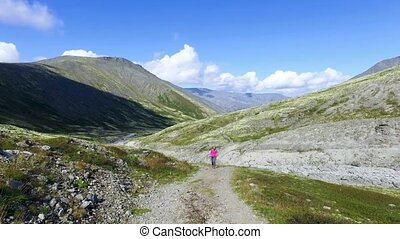 Woman Hiker Walking During Trekking, sunny day