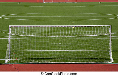 Empty soccer gol on field