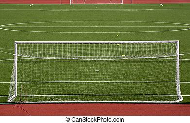 Empty soccer gol on field