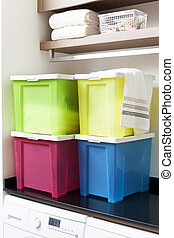 Colorful storage boxes on shelf