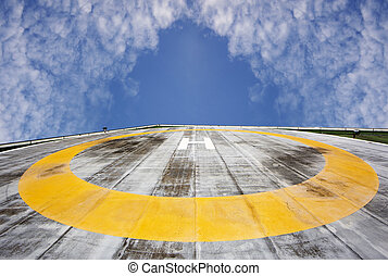Helipad on sky background