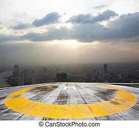 Helipad on Bangkok sunset background