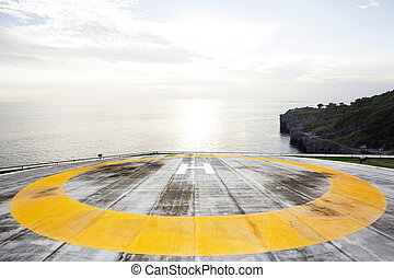 Helipad on rooftop with sea background