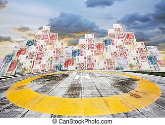 Helipad on Chinese money building background