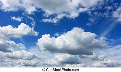 Clouds - A time lapse done of moving clouds on a clear sunny...