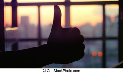 Concept of business. Silhouette hand gesture like against...