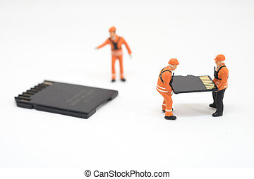 Concept of data recovery. Worker working on micro sd card.
