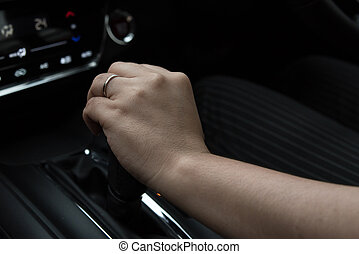 Woman hand holding gear stick - Close up of woman hand...