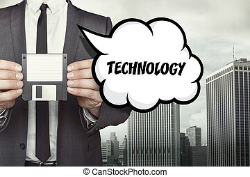 Technology text on speech bubble with businessman