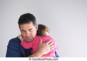 Father hugs his daughter. Parenting, fatherhood children and...